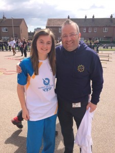 Mr Rooke with former Bramble Brae pupil and now Northfield Academy star, Hayley McMillan. Hayley was one of the pupils who carried the baton into Northfield Academy.